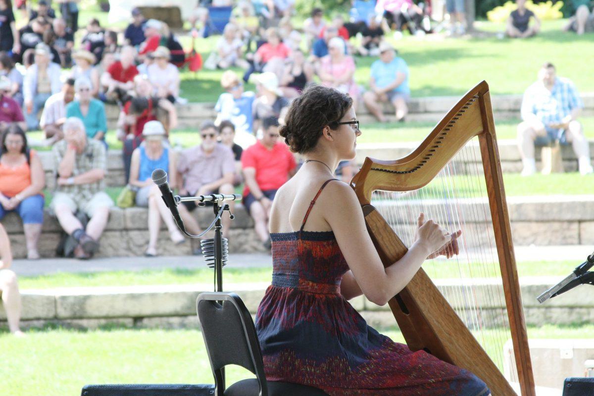 Stephanie Claussen playing harp at MN Scottish Fair